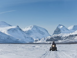 Snowmobiling in Kalix River Valley With Snow Covered Mountains, Kiruna Region, Arctic Sweden Photographic Print by Kim Walker