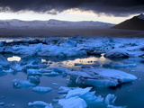 Blue Icebergs Floating on the Jokulsarlon Glacial Lagoon at Sunset, South Iceland, Iceland Photographic Print by Lee Frost