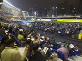 Night Race at Happy Valley Racecourse, Causeway Bay, Hong Kong, China, Asia Photographic Print by Ian Trower