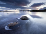 View of Loch Ba' at Dawn, Loch Partly Frozen With Two Large Rocks Protruding From the Ice, Scotland Photographic Print by Lee Frost