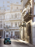 Old American Car Driving Along Quiet Street in Havana Centro, Havana, Cuba Photographic Print