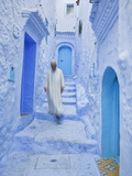 Man in Traditional Moroccan Clothes Walking Down Painted Blue and Steps, Chefchaouen, Morocco Fotografie-Druck von Guy Edwardes