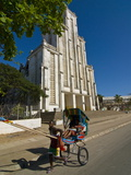 Man With a Rickshaw in Front of a Modern Church in Mahajanga, Madagascar, Africa Fotografická reprodukce