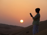 Woman Reading the Bible in the Desert, Abu Dhabi, United Arab Emirates, Middle East Photographic Print