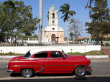 Classic Red American Car Parked By the Old Square in Vinales Village, Pinar Del Rio, Cuba Photographic Print by Lee Frost