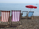 Coloured Deck Chairs on the Pebble Strand, Brighton, Sussex, England, Uk Photographic Print