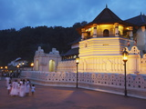 People Outside Temple of the Tooth (Sri Dalada Maligawa) at Dusk, Kandy, Sri Lanka Photographic Print by Ian Trower