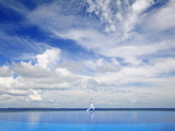 Young Man Meditating By Infinity Pool, Maldives, Indian Ocean, Asia Photographic Print by Sakis Papadopoulos