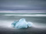 Piece of Glacial Ice Washed Ashore By the Incoming Tide Near Glacial Lagoon at Jokulsarlon, Iceland Photographic Print by Lee Frost