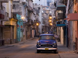 View Along Quiet Street at Dawn Showing Old American Car and Street Lights Still On, Havana, Cuba Photographic Print by Lee Frost