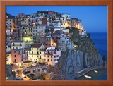 Dusk Falls on a Hillside Town Overlooking the Mediterranean Sea, Manarola, Cinque Terre, Italy Framed Photographic Print by Dennis Flaherty
