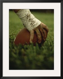 Close-up of the Hand of an American Football Player Holding a Football Framed Photographic Print