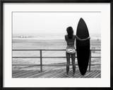 Model with Black Surfboard Standing on Boardwalk and Watching Wave on Beach Framed Photographic Print by Images Monsoon