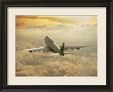 Jumbo Jet Above Clouds at 35,000 Feet Framed Photographic Print by Peter Walton