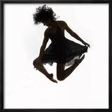 Woman Jumping in the Air Dancing Framed Photographic Print by Images Monsoon
