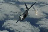 F-22 Raptor (Above Clouds, Firing) Art Poster Print Masterprint