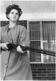 Woman in Curlers With Rifle Archival Photo Poster Photo