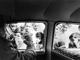 Indian children looking into puppeteer Bil Baird&#39;s car, March 1962. Premium Photographic Print by James Burke