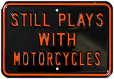 Still Plays With Motorcycles Plechová cedule