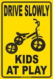 Drive Slowly Kids At Play Tin Sign