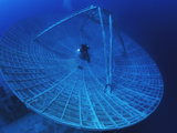A Radar Dish Atop a Sunken Ship Used to Track Missiles Photographic Print by David Doubilet