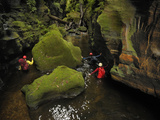 A Guide Leads a Team Through a Passage in Claustral Canyon Photographic Print by Peter Carsten