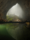 A Rock Formation Shines Beneath a Skylight in Hang Son Doong Photographic Print by Carsten Peter