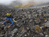 Extreme Trekkers Cross a Field of Granite Boulders Photographic Print by Michael Christopher Brown