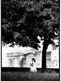 A Little Girl Picking Flowers in Florence, Italy Photographic Print by Chris Hill