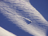 A Person Skiing Downhill in Turns over Ripples of Wind Blown Snow Photographic Print by Jed Weingarten/National Geographic My Shot