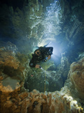 A Diver Ascends a Deep Shaft in Dan's Cave on Abaco Photographic Print by Wes C. Skiles