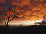Storm Clouds Glowing Orange from the Setting Sun Photographic Print by Amy & Al White & Petteway