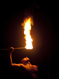 A Fire Knife Dancer Performs at the Tiki Village Theatre Photographic Print by Aaron Huey