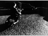 A Man on a Moped Speeding over Cobblestones in Rome Photographie par Chris Hill