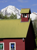 An Old Church Building and Snow-Capped Mountains Photographic Print by Robbie George