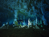 A Diver Negotiates the Cascade Room's Stalagmites in Dan's Cave Photographic Print by Wes C. Skiles