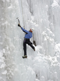 An Ice Climber Negotiates a Wall of Ice Photographic Print by Robbie George