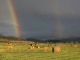 A Double Rainbow Appears over Hay Bales in Mountain Field Photographic Print by Robbie George