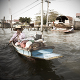 A Vendor Sells Her Goods from a Small Canoe on the Chao Phraya River Photographic Print by Keith Barraclough