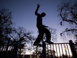 A Teenager Practices a Parkour Move at a Playground Photographic Print by Kitra Cahana