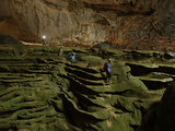 Hang Son Doong Explorers Navigate An Algae-Covered Cavescape Photographic Print by Carsten Peter