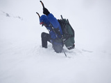An Extreme Trekker Struggles in Deep Snow Photographic Print by Michael Christopher Brown