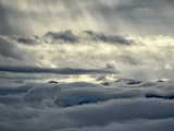 Sunlight Shines Through Clouds on a Sea of Clouds Below Photographic Print by Amy & Al White & Petteway