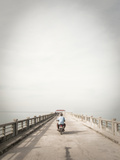 A Motorcyclist Drives Down a Pier on the Andaman Sea Photographic Print by Keith Barraclough