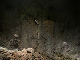 A Climber Descends 225 Feet By Rope Into Hang Loong Con Photographic Print by Peter Carsten