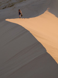 Woman Walking Through Kelso Dunes, Mojave Desert National Reserve, California, United States of Ame Photographic Print by Colin Brynn