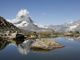 Hiker Resting at Riffelsee and the Matterhorn Behind, Zermatt, Valais, Swiss Alps, Switzerland, Eur Photographic Print by Hans-Peter Merten