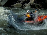 A River Kayak Spins Off a Wave Stampa fotografica di Robbie George
