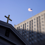 The Cross at Saint Peter's Church and the American Flag in the Distance Photographic Print by Keith Barraclough