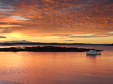 A Lobster Boat in Calm Water at Sunrise Photographic Print by Robbie George